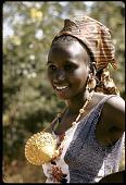 view Conde Tiemoko wearing large gold bicone bead, Bamako, Mali digital asset: Conde Tiemoko wearing large gold bicone bead, Bamako, Mali