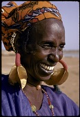 "view Woman with four-lobed gold earrings, known locally as ""kwottenai,"" Mopti, Mali digital asset: Woman with four-lobed gold earrings, known locally as ""kwottenai,"" Mopti, Mali"