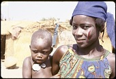 view Dendi woman and child with facial paint and scarifications, near Gaya village, Niger digital asset: Dendi woman and child with facial paint and scarifications, near Gaya village, Niger