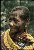 view Mbuti woman with facial paint, Epulu, Ituri Forest, Congo (Democratic Republic) digital asset: Mbuti woman with facial paint, Epulu, Ituri Forest, Congo (Democratic Republic)