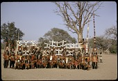 view A group of 30 Dogon masks before a public performance, Sanga region, Mali digital asset: A group of 30 Dogon masks before a public performance, Sanga region, Mali