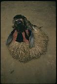 view Bassa masquerader performing Geh-naw forehead mask, Ganta Mission, Liberia digital asset: Bassa masquerader performing Geh-naw forehead mask, Ganta Mission, Liberia