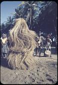 view Masquerader performing the mask Gbetu, Monrovia, Liberia digital asset: Masquerader performing the mask Gbetu, Monrovia, Liberia