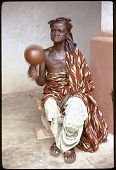 view Musician in the courtyard of the shrine house, Besease, Ghana digital asset: Musician in the courtyard of the shrine house, Besease, Ghana