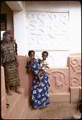 view Asante women and child in shrine house courtyard, Besease, Ghana digital asset: Asante women and child in shrine house courtyard, Besease, Ghana