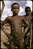 view Dakpa boy, with white dots painted on his body, dancing at his initiaton rites, Ubangi-Shari region, Central African Republic digital asset: Dakpa boy, with white dots painted on his body, dancing at his initiaton rites, Ubangi-Shari region, Central African Republic