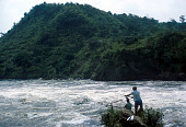 view Man fishing on the White Nile, Uganda digital asset: Man fishing on the White Nile, Uganda