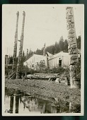view Totem Pole Nos 17, 12, 11, 18, 15, 10; Wood Plank Houses Nearby 1922 digital asset number 1