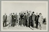 view Group of Non-Native Men and Woman in Front of Monument digital asset: Group of Non-Native Men and Woman in Front of Monument