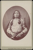 view Portrait of One Bull, 27 Years Old, Nephew of Sitting Bull, In Native Dress and Holding Club 1882 digital asset number 1