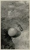 view Pottery Shards and Inverted Globular Pottery Bowl with Stamped Design in Situ; Metal Clippers Nearby 1925 digital asset number 1
