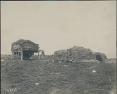 view Two Women in Native Dress Outside Barabara (Sod House) And Storage Dump n.d digital asset number 1