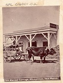 "view Non-Native Man on Ox Cart, Outside Masonry Commercial Building with Sign Reading, ""C. W. Lewis"" n.d digital asset number 1"