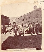 view Group of Non-Native Men, Boys and Native or Mexican ? Men with Group of Saddled Burros Outside Adobe Buildings n.d digital asset number 1