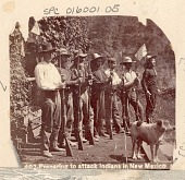 view Seven Non-Native Men, Soldiers ?, with Rifles, Bayonets, And American Flag, Preparing for Indian Attack n.d digital asset number 1