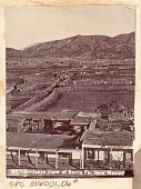 view View, from Above, of Town, Showing Masonry Houses, Road, Plowed Fields, Graveyard, and Mountains in Background n.d digital asset number 1