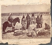 view Group, in Partial Native Dress, One Wearing Civil War-Style Jacket, One on Horseback, Watching Two Men ? Butcher Cow 1868 digital asset number 1