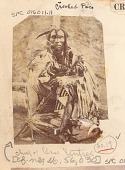 view Chief, Lean Wolf ?, Wearing Buckskin Leggings and Shirt Decorated with Quill Work and Ermine, Outside Earth Lodge ? 1866 digital asset number 1