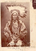 view Portrait of Crow Flies High, Old Man in Native Dress, With Feather Headdress and Sword n.d digital asset number 1