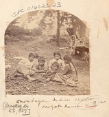 view Group of Children, One Wearing Moccasins, Beside Wooden Boat digital asset: Group of Children, One Wearing Moccasins, Beside Wooden Boat