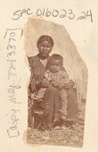 view Woman and Child, Both in Partial Native Dress, Outside Reed Lodge n.d digital asset number 1