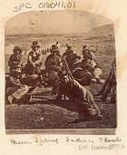 view Group of Men, Army Scouts, Recruited for Modoc War, Including Frank Sidwaller, Pinouse, Schooley, Jake Thomas, All in Military Uniform and with Guns; Tents in Background Near Tule Lake digital asset: Group of Men, Army Scouts, Recruited for Modoc War, Including Frank Sidwaller, Pinouse, Schooley, Jake Thomas, All in Military Uniform and with Guns; Tents in Background Near Tule Lake.