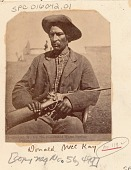 view Chief Donald McKay, Army Scout, Recruited for Modoc War, With Rifle; Tents in Background Near Tule Lake digital asset: Chief Donald McKay, Army Scout, Recruited for Modoc War, With Rifle; Tents in Background Near Tule Lake.