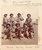 view Group of Men, Army Scouts Recruited for Modoc War, in Military Uniform and with Rifles; Tents in Background Near Tule Lake digital asset: Group of Men, Army Scouts Recruited for Modoc War, in Military Uniform and with Rifles; Tents in Background Near Tule Lake.