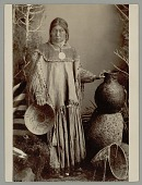 view Portrait of Young Woman in Native Dress with Blanket, Pitch- Covered Basket Jug, and Baskets 1888 digital asset number 1