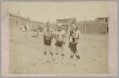 view Three Cochiti Medicine Men with Body Paint and in Costume; Group of Women in Costume and Adobe Cluster Behind Them n.d digital asset number 1