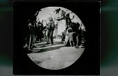 view Ceremony, Tasap Kachina (Possibly Powamu So-Aum, Grandmother) and Old Man With Blanket and Rattle? Dancing in Plaza; Spectators Outside Adpbe House Cluster [28 Feb 1893] digital asset number 1