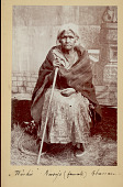 view Portrait of Washie, Female Shaman from Fort Wingate, 106 Years Old?, Wearing Blanket and Moccasins and Holding Wood Staff? Or Cane? digital asset: Portrait of Washie, Female Shaman from Fort Wingate, 106 Years Old?, Wearing Blanket and Moccasins and Holding Wood Staff? Or Cane?