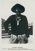 view Adik-Ai Bitsul, Called Charlie Mitchell, Medicing Man, Wearing Silver Concho Belt and Turquoise Necklaces digital asset: Adik-Ai Bitsul, Called Charlie Mitchell, Medicing Man, Wearing Silver Concho Belt and Turquoise Necklaces