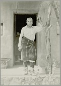 view Martin Vigil, Lieutenant Governor of Tesuque Pueblo, in Partial Native Dress Outside Adobe House Structure 1931 digital asset number 1