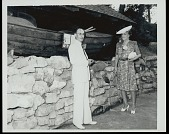 view Man and Mary Dean Powell, John Wesley Powell's daughter, by wood boat, 1941 digital asset number 1
