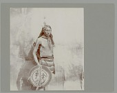view Portrait of Tonka-Wicakin (Takes Enemy) with face and body paint and holding painted shield Copyright 19 AUG 1901 digital asset number 1