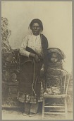 view Portrait of woman with blanket beside infant in cradleboard on chair Copyright 08 DEC 1906 digital asset number 1