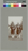 view Two women with water jars on heads near palm trees Copyright 12 FEB 1897 digital asset number 1