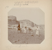 view Two Men in Costume and Non-Native Woman (Mary Alice?) or (Helen Hamilton Gardener?) on Donkey in Desert; Saddled Donkey Nearby digital asset: Two Men in Costume and Non-Native Woman (Mary Alice?) or (Helen Hamilton Gardener?) on Donkey in Desert; Saddled Donkey Nearby