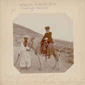 """view Man in Costume Beside Non-Native Woman (Mary Alice?) with Lamb on Painted and Saddled Donkey Called """"Mary Anderson"""", in Costume digital asset: Man in Costume Beside Non-Native Woman (Mary Alice?) with Lamb on Painted and Saddled Donkey Called """"Mary Anderson"""", in Costume"""