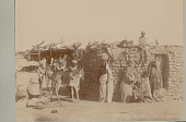 view Group in Costume with Baskets and Saddled Donkeys Outside Mud Brick House 1865 digital asset number 1