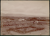 view View of Building Complex (Tapkaneh?) of Old Capital City of Rey; Group in Costume in Plaza with Cannons Near Landscaped Pool In Center; Mountains Beyond 1890 digital asset number 1