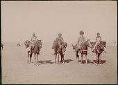 view Four Men in Costume, Leaders of Caravan, on Horseback; Cannon And Palace in Background 1896 digital asset number 1