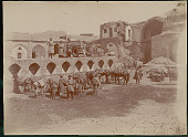 view Group of Men in Costume with Horses Bearing Goods at Courtyard of Caravansarai?; Men Clearing Brick Rubble with Shovels Near Ruins in Background 1896 digital asset number 1