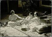 view Three Women in Costume, Drinking Tea on Oriental Rugs in Courtyard of Harem 1959 digital asset number 1