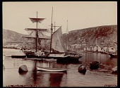 view Sailing ships in harbor near village and mountains, with three boys and smaller boats nearby 1892 digital asset number 1