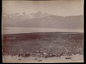 view Elevated view of town and port with snow-covered mountains and islands in distance 1892 digital asset number 1