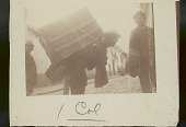 view Three Quechua Men in Costume on Cobbled Street; One with Trunk Strapped to Back n.d digital asset number 1
