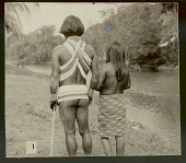 view Choco Man in Ceremonial Costume and Woman in Costume at River's Edge (Back View) 1923 digital asset number 1