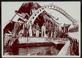 view Group of Non-Native Men, Some in Uniform, on Wreckage of Ship In Harbor n.d digital asset number 1